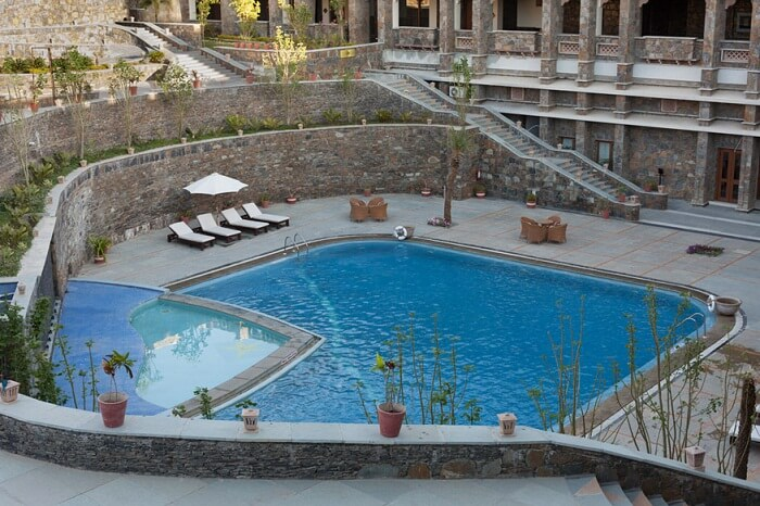 Swimming pool and stone stairways leading to the pool at Ramada Resort near Udaipur