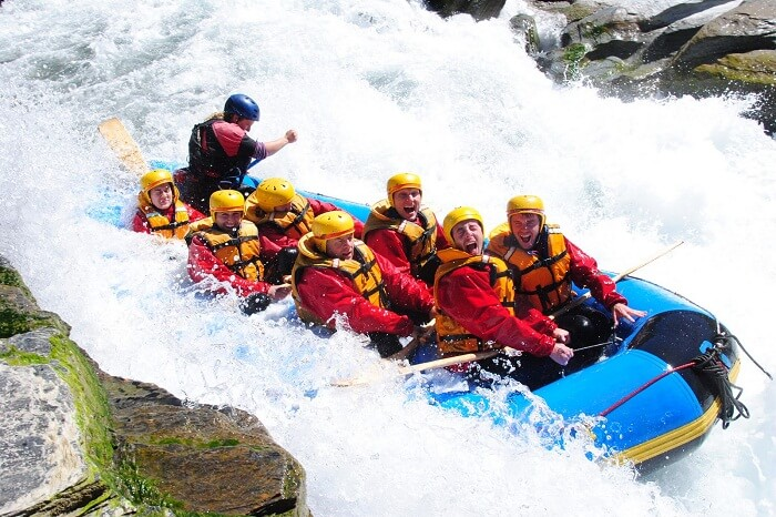 Foreigners trying river rafting in Rishikesh