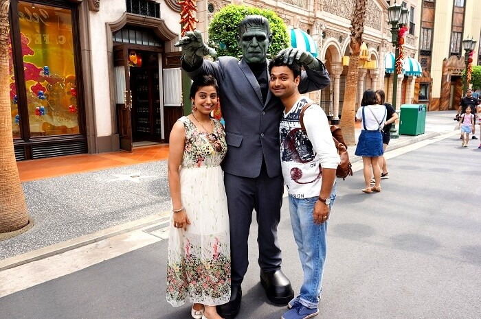 Bhargav and his wife pose in Universal Studio Singapore