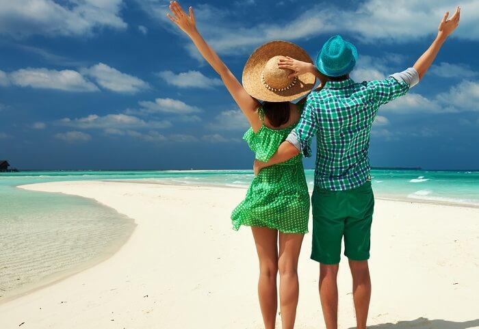 Couple strolling around on Lakshadweep Beach