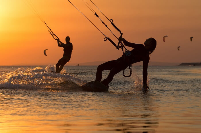 Couple enjoying kitesurfing on their Lakshadweep honeymoon