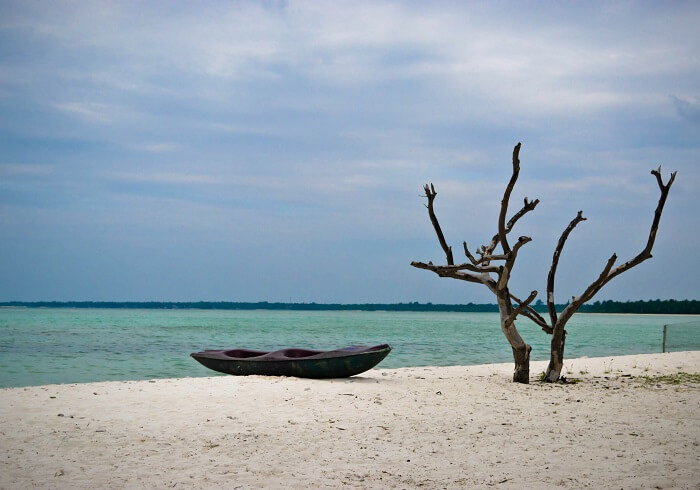 A lone canoe set ashore on Minicoy Island in Lakshadweep