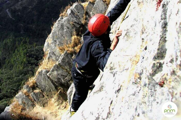 A participant climbing the rocks in Mussoorie
