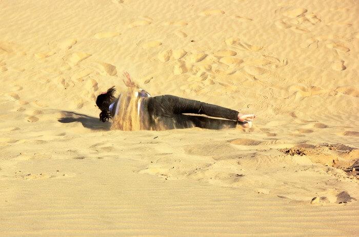 Swati rolling in Sam Sandunes, Jaisalmer
