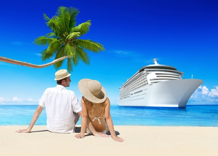 Couple gazing out at passenger ships that commute tourists between Lakshadweep and mainland