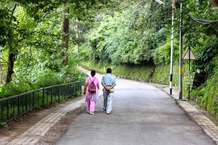 A couple takes a casual and romantic walk from Lower Mall to Kimmughat in Kasauli