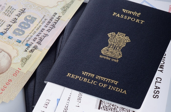 Picture of Indian passport, boarding pass and currency