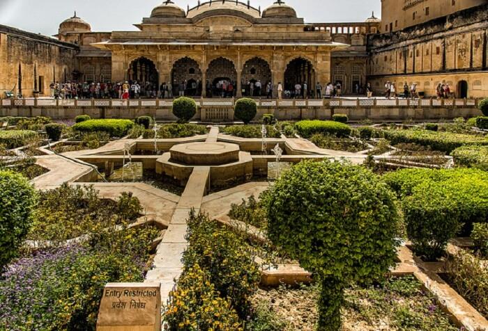 Tourists explore the popular Vidyadhar Garden near Jaipur
