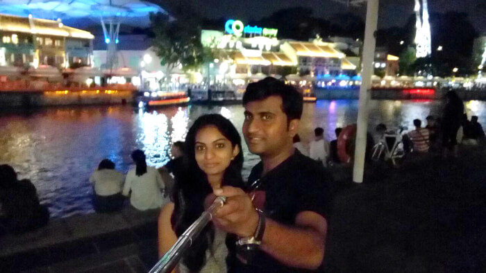 Pooja and her husband click a selfie in Singapore