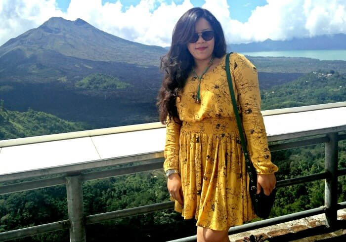 Ritika poses in Bali with Volcano in her background