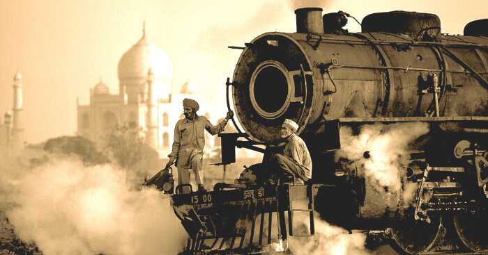 A vintage photo of India showing a steam engine and the Taj Mahal