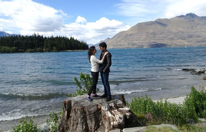 Vinamra and Ankita posing in the scenic background of Queenstown