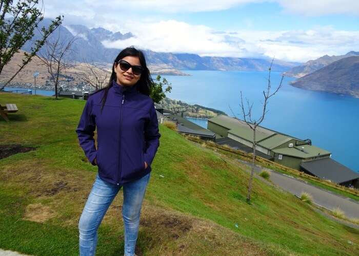Anikta in the background of scenery in Queenstown
