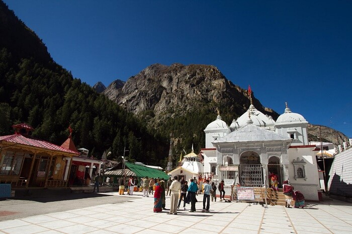 Pilgrims stop to offer prayers at the Gangotri Temple