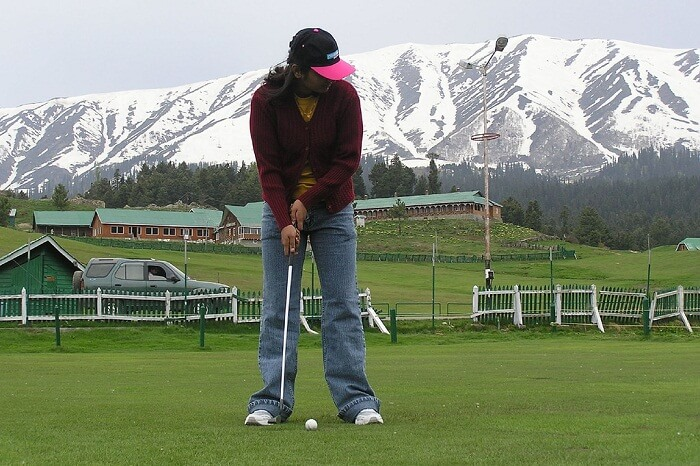 A tourist ready to tee off at the Gulmarg golf course