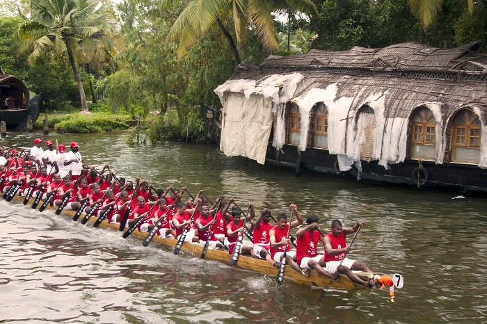 Group of men from Kerala drive a snake boat at the annual boat race event in the Vembanad Lake