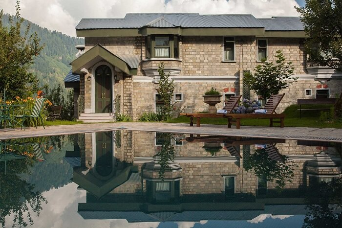 A beautiful quaint cottage facing swimming pool at The Himalayan Spa Resort in Manali