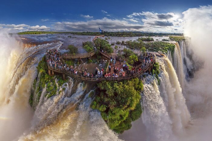 Tourists gather at the top of the Iguazu Falls at the border of Argentina and Brazil