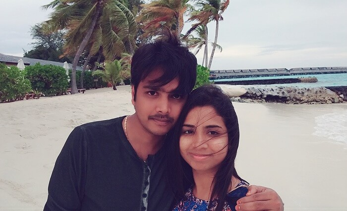 Badri and his wife pose for a photo in Maldives