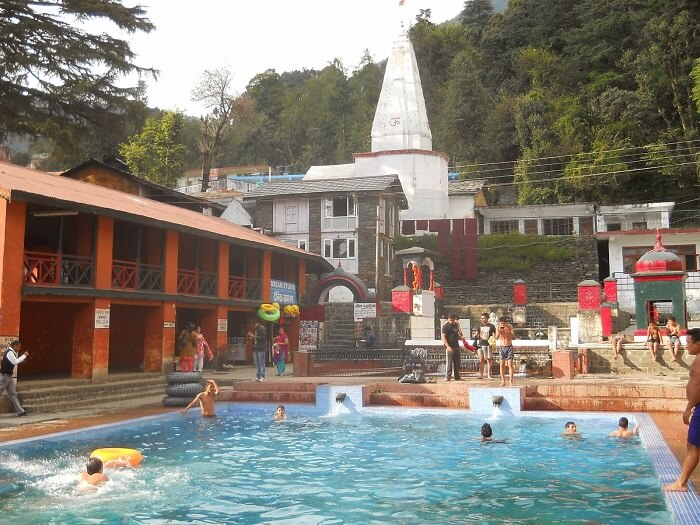 Open pool and Bhagsunag Temple in its backdrop in Dharamshala