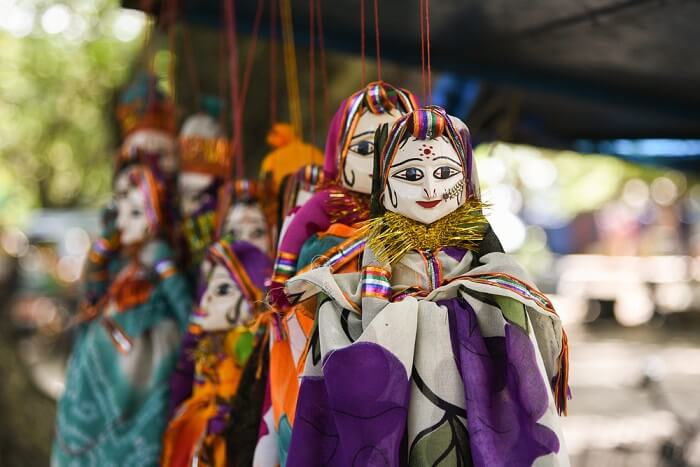 Rajasthani puppet dolls hanging from a cord at Chetak Circle in Udaipur