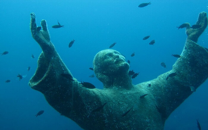 This 2.5 meter bronze statue is located off the coast of Portofino in Italy.