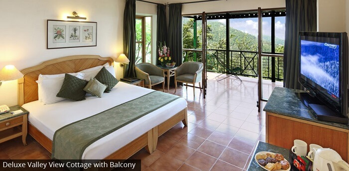 Beautifully decorated deluxe valley-view cottage at Baikunth Resort in Kasauli