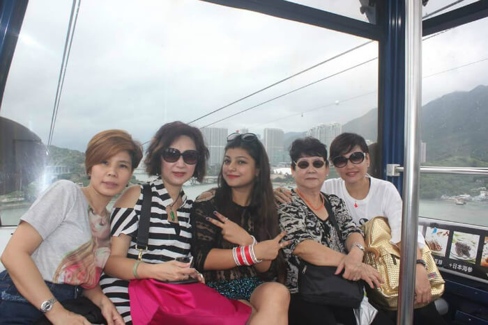 Mituls wife with people in a cable car ride in Hong Kong