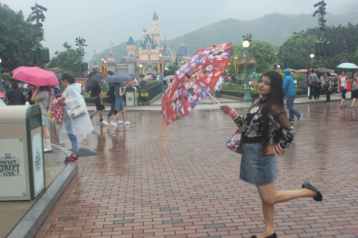 Mitul's wife in Disneyland in Hong Kong