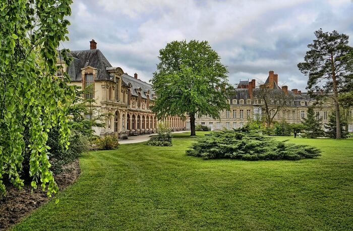 Royal gardens of Palace of Fontainebleau in France