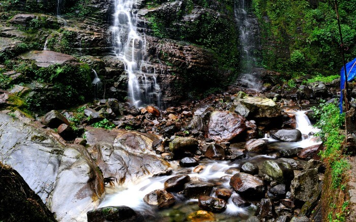 Enliven your soul splashing around the beautiful Kanchenjunga Falls