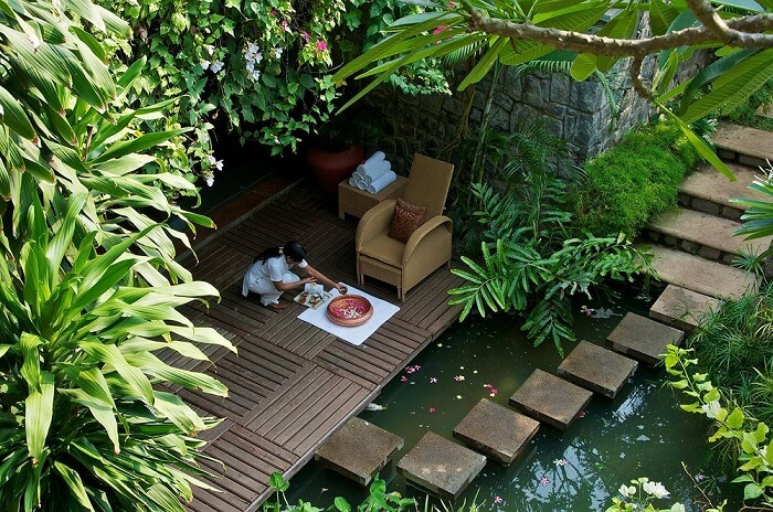 Comfortable relaxation setting amidst the natural greenery at Green Cove Resort in Kovalam