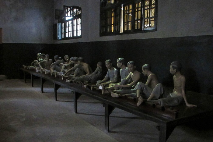 Sculptures inside the Hỏa Lò Prison turned museum in Vietnam