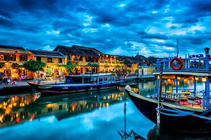 A beautiful view of the boat and shore of the canal in Hoi An Ancient Town