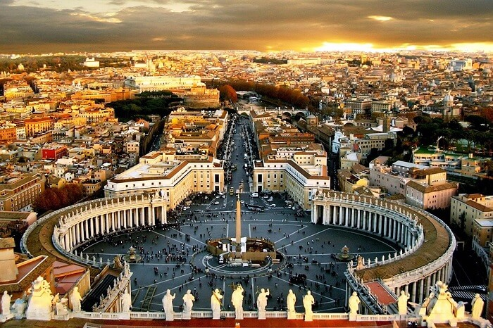 The entry to the famous St. Peter's Square marks the border between Italy and the sovereign Catholic city-state of Vatican City.