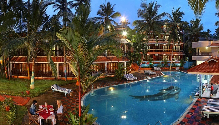 A soothing pool-side scene from Jasmine Palace Hotel - One of the best economy resorts in Kovalam
