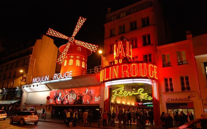 The facade of classic cabaret venue - Moulin Rouge in Paris