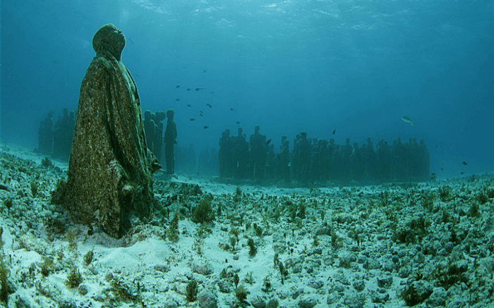 Statues of people whose remains were used to create the Neptune Memorial Reef.