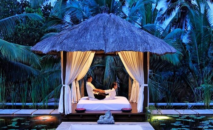 An outdoor spa-massage station at Niraamaya Retreats in Kovalam
