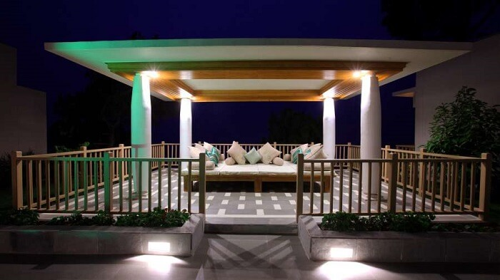 Cozy outdoor lounge perfect to enjoy great weather of Himachal at Moksha Spa Resort in Parwanoo