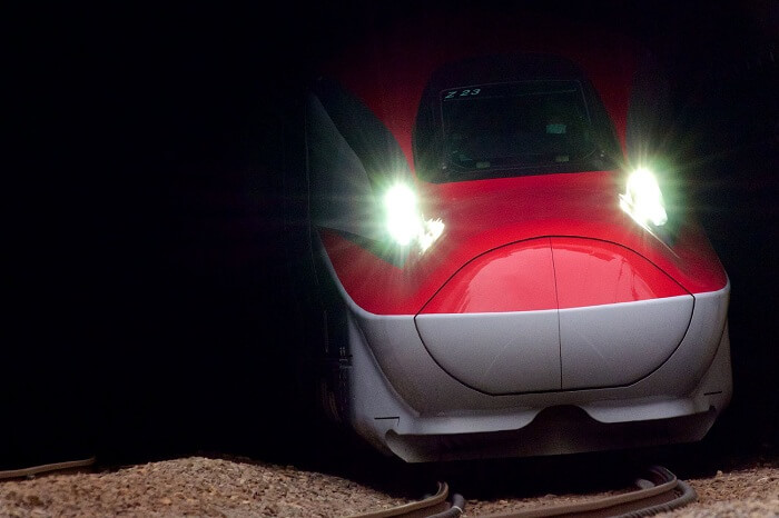 A snap of the Shinkansen bullet train exiting a tunnel