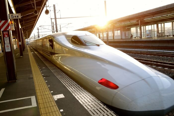 The Shinkanse bullet train stadning at the railway station