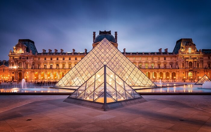 Glass exterior of The Louvre - the most popular art museum in Paris