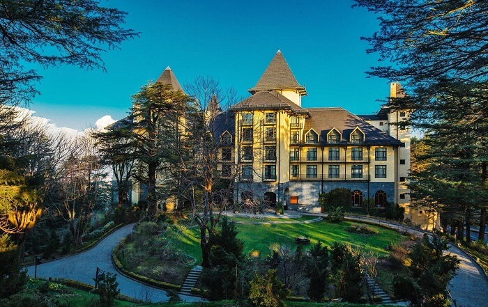 The opulent exterior of Wildflower Hall Resort in Shimla - one of the best luxury resorts in Himachal Pradesh
