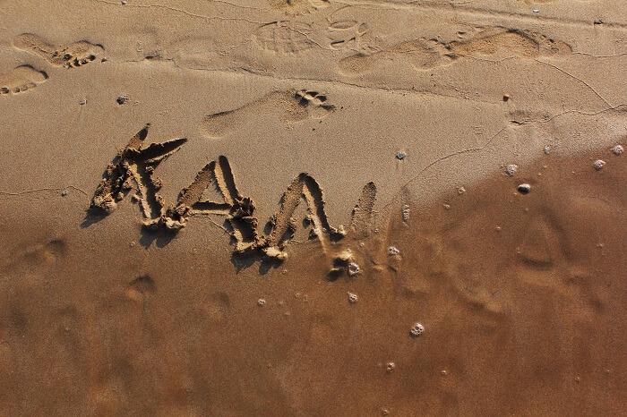 Kanikas name in the sand on a beach in Sri Lanka