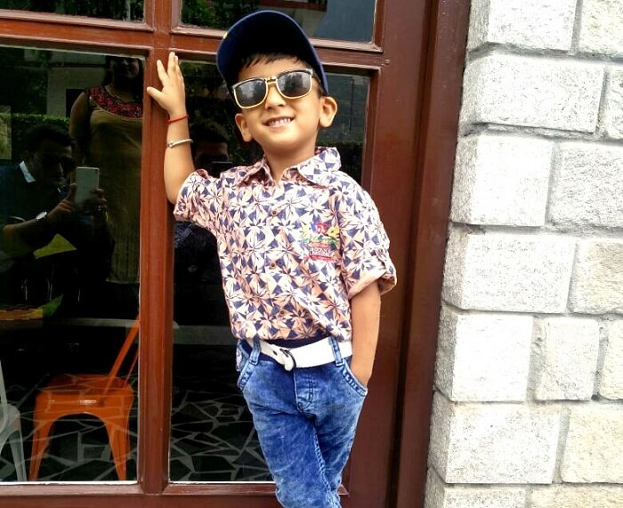 Sachins son poses outside their hotel in Manali