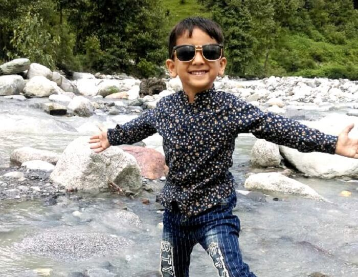 Sachins son having fun in the river in Himachal