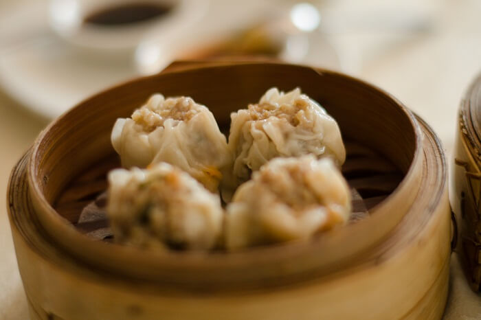 A pot full of dimsums being served in a Mauritius diner