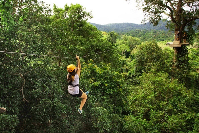 A tourist tries ziplining that is one of the best things to do in Pattaya