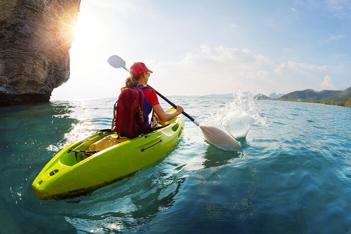 A woman tries sea kayaking in Koh Samui